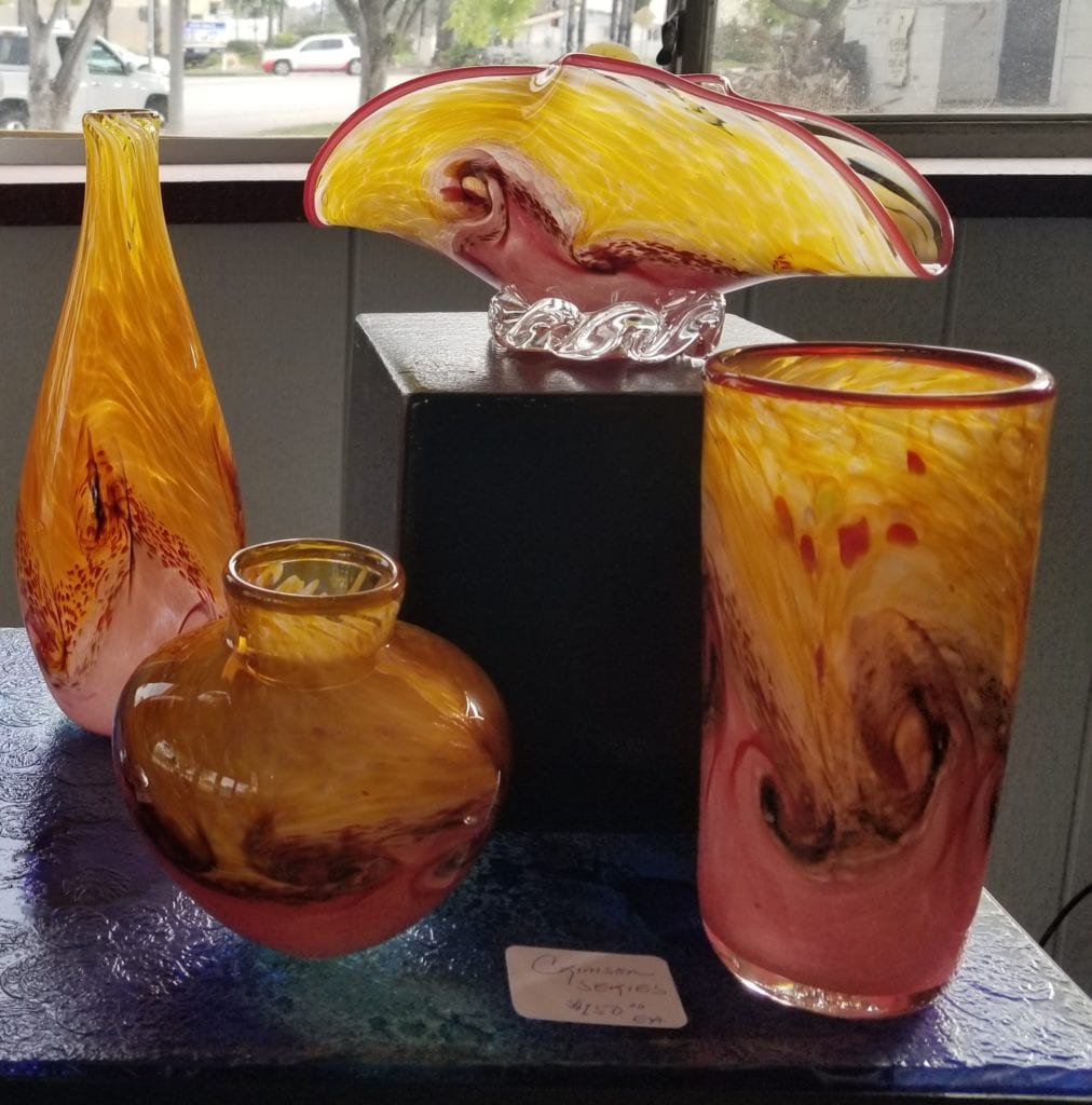 several yellow and red glass sculptures
